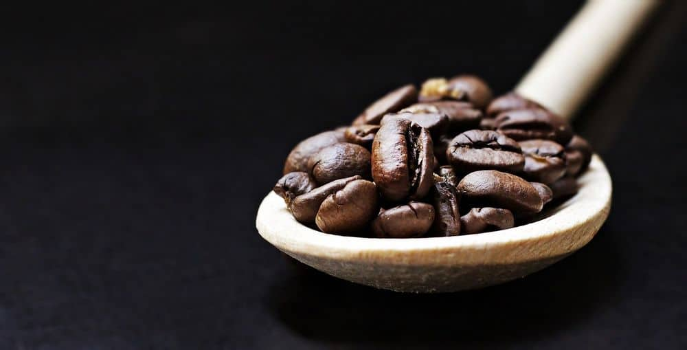 roasted coffee in spoon